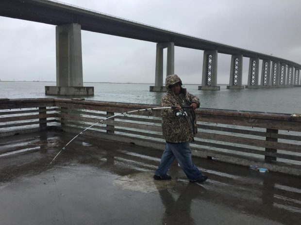 Salvador Garcia casts off the Antioch Bridge Peer amid the storm on Friday Oct. 14, 2016. He, along with a half dozen other residents, haven't been put off by the rain. Instead, he is looking to catch another sturgeon like the one he caught Thursday night. (Aaron Davis, East Bay Times)