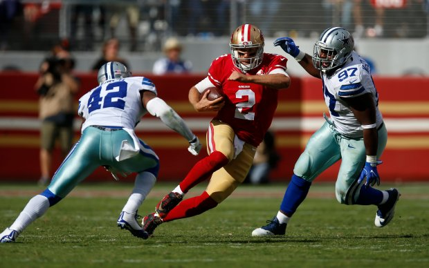 San Francisco 49ers starting quarterback Blaine Gabbert (2) scrambles against Dallas Cowboys' Barry Church (42) and Dallas Cowboys' Terrell McClain (97) in the third quarter of their NFL game at Levi's Stadium in Santa Clara, Calif., on Sunday, Oct. 2, 2016. (Nhat V. Meyer/Bay Area News Group)