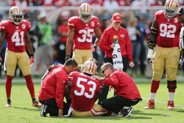 San Francisco 49ers' NaVorro Bowman (53) gets medical attention on the field in the second half of an NFL game against the Dallas Cowboys at Levi's Stadium in Santa Clara, Calif., on Sunday, Oct. 2, 2016. (Josie Lepe/Bay Area News Group)