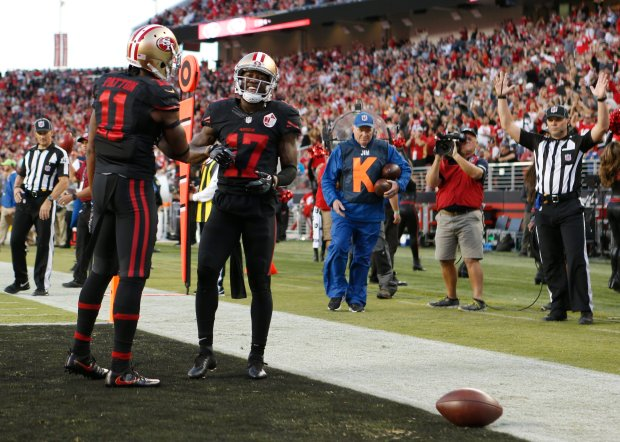 San Francisco 49ers' Quinton Patton (11) celebrates with San Francisco 49ers' Jeremy Kerley (17), who scores touchdown against Arizona Cardinals in the first half in their NFL game at Levi's Stadium in Santa Clara, Calif., on Thursday, Oct. 6, 2016. (Josie Lepe/Bay Area News Group)