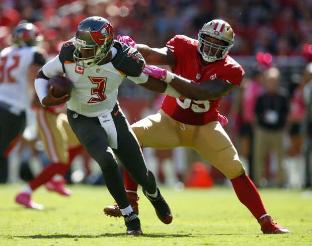 Tampa Bay Buccaneers starting quarterback Jameis Winston (3) avoids a sack against San Francisco 49ers' Aaron Lynch (59) in the first quarter of an NFL game at Levi's Stadium in Santa Clara, Calif., on Sunday, Oct. 23, 2016. (Nhat V. Meyer/Bay Area News Group)