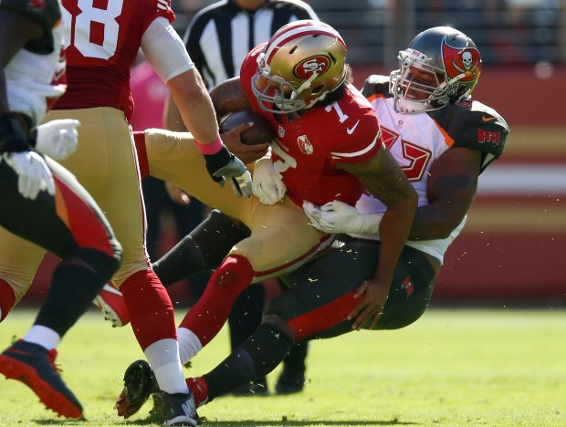 San Francisco 49ers starting quarterback Colin Kaepernick (7) is sacked by Tampa Bay Buccaneers' William Gholston (92) in the first quarter of an NFL game at Levi's Stadium in Santa Clara, Calif., on Sunday, Oct. 23, 2016. (Nhat V. Meyer/Bay Area News Group)