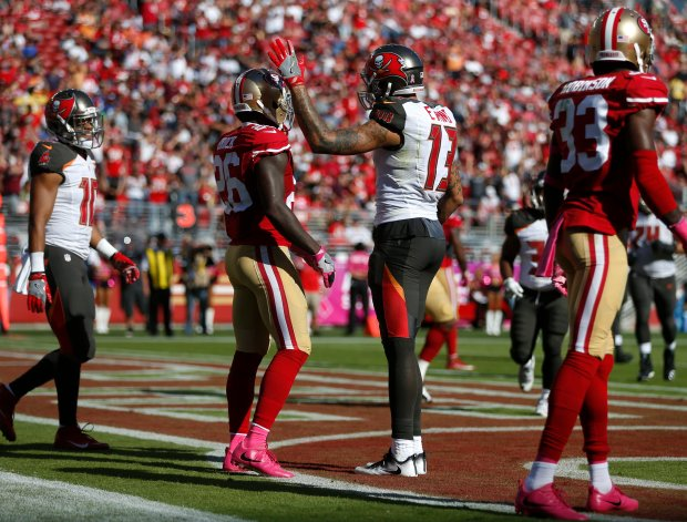 Tampa Bay Buccaneers' Mike Evans (13) taps San Francisco 49ers' Tramaine Brock (26) on the helmet after making a touchdown catch in the third quarter of their NFL game at Levi's Stadium in Santa Clara, Calif., on Sunday, Oct. 23, 2016. (Nhat V. Meyer/Bay Area News Group)