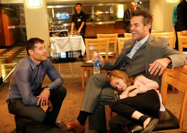 Sharks, Patrick Marleau, left, chats with Dan Boyle, right, before Boyle announces his retirement from hockey during a press conference held at the SAP Center in San Jose, Calif., on Wednesday, Oct. 5, 2016. Boyle was the highest-scoring defenseman in Sharks history. At right is Boyle's daughter, Eastin Boyle, 7. (Gary Reyes/Bay Area News Group)