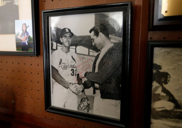 A photograph of Ernie Broglio, left, shaking hands with former MLB player Sandy Koufax, hangs in Broglio's home in San Jose, Calif., on Thursday, Oct. 20, 2016. (Nhat V. Meyer/Bay Area News Group)