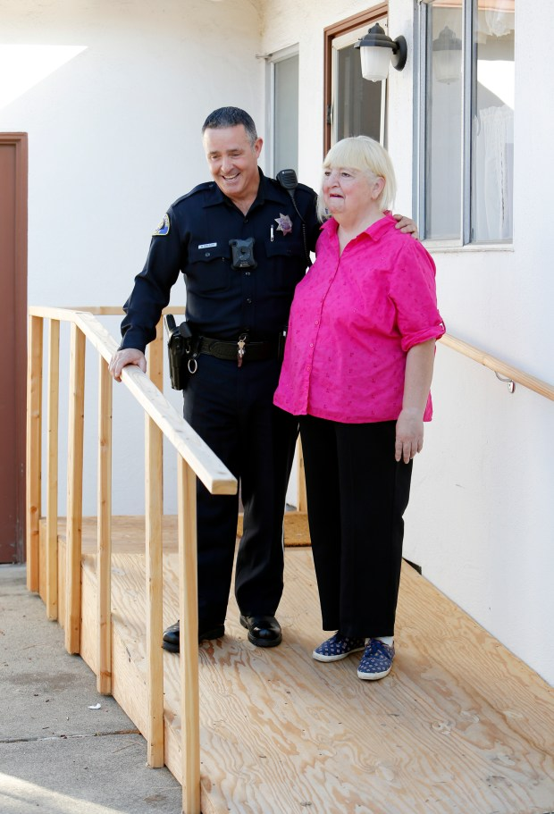 San Jose police officer Michael Roberson, converses with Mary Ellen Cancilla on the handicap ramp he built on his own time an money in San Jose, Calif., on Tuesday, Oct. 18, 2016. Officer Roberson helped rescue Cancilla, who had fallen in her home. While she was in rehabilitation he proceeded to spend his own time and money fixing up her house. (Josie Lepe/Bay Area News Group)