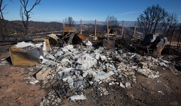 A house on a hilltop lies in ruins as officials from the Santa Clara Valley Open Space Authority tour the site of the Loma Fire in the Santa Cruz Mountains near Morgan Hill on Thursday, Oct. 20, 2016. The fire charred nearly 5,000 acres in southern Santa Clara County recently. Officials from the Santa Clara Valley Open Space Authority went to see the damage, including erosion from the Oct. 15-16 storms, which dumped nearly 10 inches of rain on the area. (Patrick Tehan/Bay Area News Group)