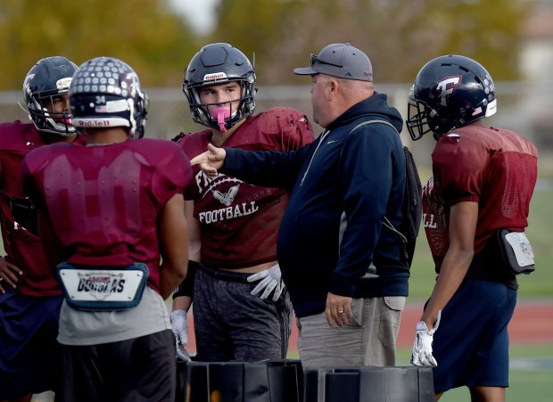 Freedom High linebacker Kyle Harmon,17, center, listens to defensive coordinator Sam Arnold during practice at Freedom in Oakley, Calif., on Monday, Oct. 24, 2016. Harmon has overcome adversity and has been approached by fifteen colleges so far to play for them. (Susan Tripp Pollard/Bay Area News Group)
