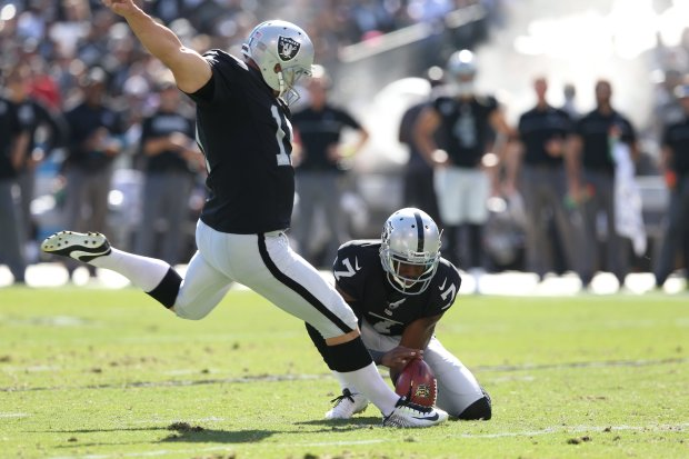 Oakland Raiders kicker Sebastian Janikowski (11) and placeholder Marquette King (7) score a field goal in the second quarter of their NFL game against the San Diego Chargers at the Coliseum in Oakland, Calif., on Sunday, Oct. 9, 2016. (Anda Chu/Bay Area News Group)