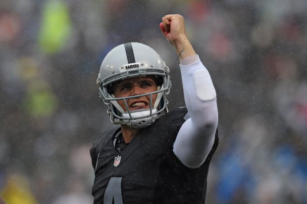 Oakland Raiders quarterback Derek Carr (4) gestures after throwing a touchdown pass to Oakland Raiders' Andre Holmes (18) in the first quarter of their game at the Coliseum in Oakland, Calif., on Sunday, Oct. 16, 2016. (Jose Carlos Fajardo/Bay Area News Group)