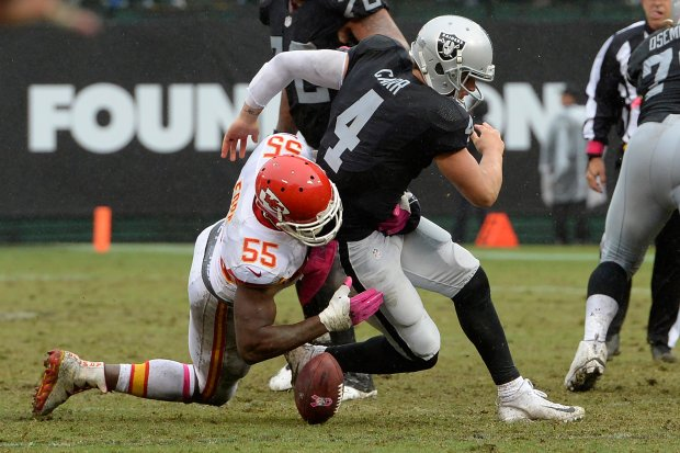 Oakland Raiders quarterback Derek Carr (4) fumble the ball after being sacked by Kansas City Chiefs' Dee Ford (55) in the fourth quarter of their NFL game at the Coliseum in Oakland, Calif., on Sunday, Oct. 16, 2016. Kansas City defeated Oakland 26-10. (Jose Carlos Fajardo/Bay Area News Group)