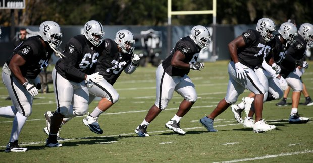 The Oakland Raiders offensive line run drills during practice at their headquarters in Alameda, Calif., on Wednesday, Oct. 19, 2016. (Jane Tyska/Bay Area News Group)