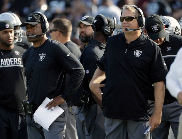 Oakland Raiders defensive coordinator Ken Norton Jr., left, and head coach Jack Del Rio watch from the sideline during the second half of an NFL football game against the San Diego Chargers in Oakland, Calif., Sunday, Oct. 9, 2016. (AP Photo/Marcio Jose Sanchez)