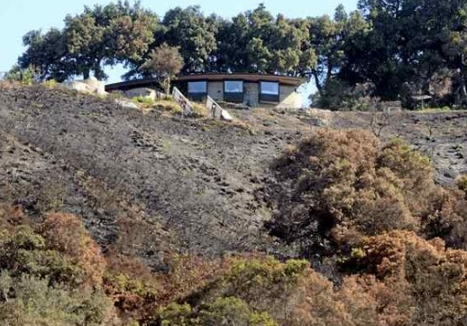 A home that survived the Soberanes Fire is surrounded by a charred hillside in Palo Colorado Canyon. (David Royal - Monterey Herald)