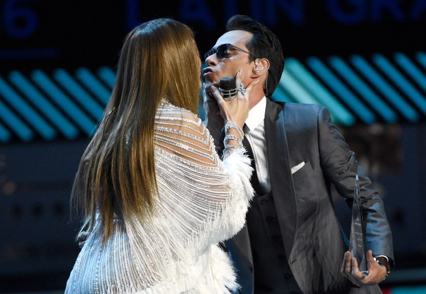 Jennifer Lopez, left, kisses Marc Anthony after presenting the person of the year award at the 17th annual Latin Grammy Awards at the T-Mobile Arena on Thursday, Nov. 17, 2016, in Las Vegas. (Photo by Chris Pizzello/Invision/AP)