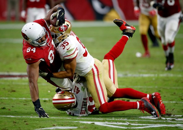Arizona Cardinals tight end Jermaine Gresham (84) is hit by San Francisco 49ers free safety Eric Reid (35) during the second half of an NFL football game, Sunday, Nov. 13, 2016, in Glendale, Ariz. (AP Photo/Ross D. Franklin)