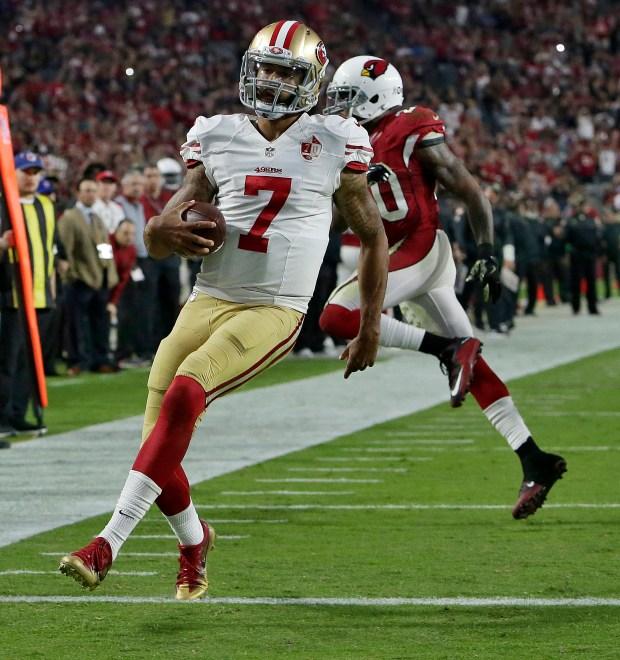 9dbb72360fb San Francisco 49ers quarterback Colin Kaepernick (7) runs for a touchdown  as Arizona Cardinals