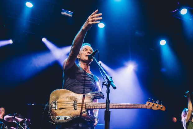 """This hand out picture taken and released by Hans Lucas on November 12, 2016 at the Bataclan concert hall in Paris shows British musician Sting playing during the reopening concert to mark the first anniversary of the November 13 Paris attacks. / AFP PHOTO / Hans Lucas / Boris Allin / RESTRICTED TO EDITORIAL USE - MANDATORY CREDIT """"AFP PHOTO / BORIS ALLIN / HANS LUCAS"""" - NO MARKETING NO ADVERTISING CAMPAIGNS - DISTRIBUTED AS A SERVICE TO CLIENTS BORIS ALLIN/AFP/Getty Images"""