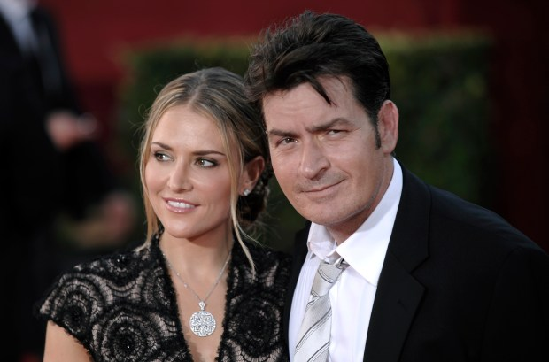 Actor Charlie Sheen, right, and wife Brooke Mueller arrive at the 61st Primetime Emmy Awards on Sunday, Sept. 20, 2009, in Los Angeles. (AP Photo/Chris Pizzello)