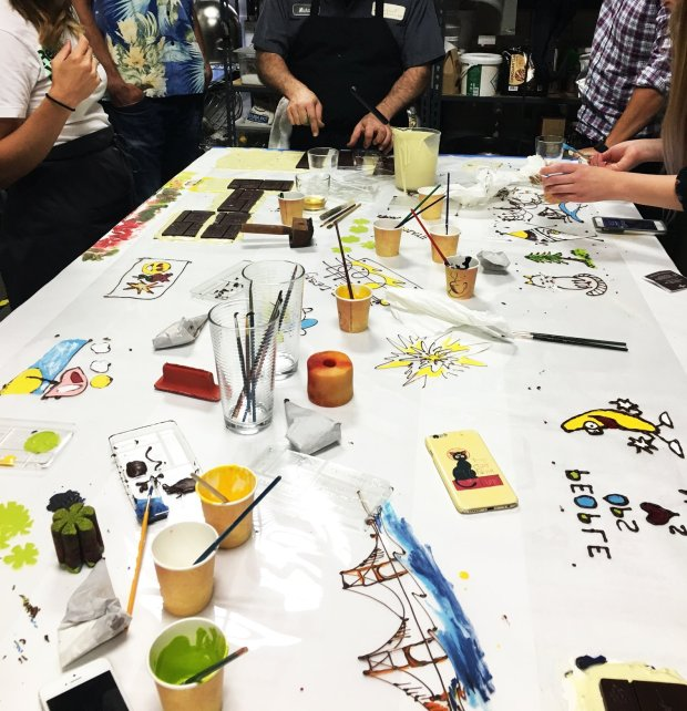 COURTESY RECCHIUTI CONFECTIONS Guests paint chocolate bars with tinted cocoa butter to create one-of-a-kind edible works of art at one of Recchiuti' Confections' Artbar Workshops.
