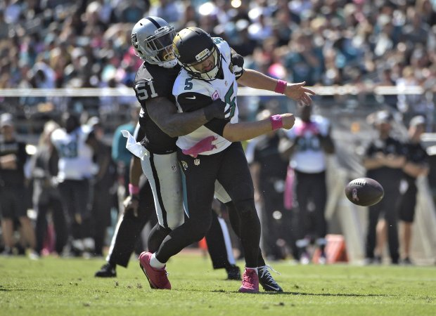 Jacksonville Jaguars quarterback Blake Bortles (5) os hit by Oakland Raiders outside linebacker Bruce Irvin (51) during the first quarter of an NFL football game Sunday, Oct. 23, 2016, in Jacksonville, Fla. (AP Photo/Phelan Ebenhack)