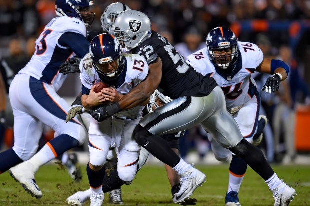Oakland Raiders' Khalil Mack (52) sacks Denver Broncos starting quarterback Trevor Siemian (13) in the third quarter of their NFL game at the Coliseum in Oakland, Calif., on Sunday, Nov. 6, 2016. The Raiders defeated the Broncos 30-20. (Jose Carlos Fajardo/Bay Area News Group)