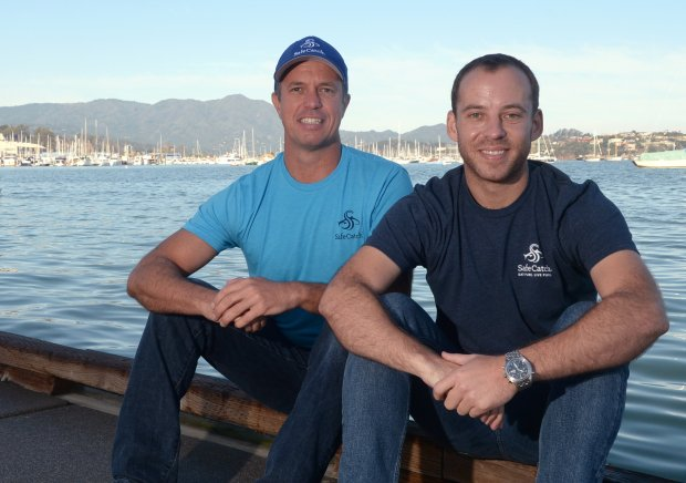 Safe Catch co-founders Bryan Boches, left, and Sean Wittenberg sit on a dock near their Sausalito, Calif. offices on Tuesday, Nov. 2, 2016. (Alan Dep/Marin Independent Journal)