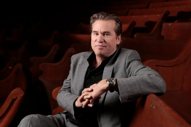 """FILE - In this Jan. 9, 2014 file photo, Val Kilmer poses for a portrait in Nashville, Tenn. Kilmer says Michael Douglas was """"misinformed"""" when he suggested Kilmer has cancer. In a Facebook post Tuesday, Nov. 1, 2016, Kilmer said he has """"no cancer whatsoever."""" At a London event on Sunday, Douglas had said Kilmer was """"dealing with"""" throat cancer, which Douglas was diagnosed with in 2010. (AP Photo/Mark Humphrey, File)"""