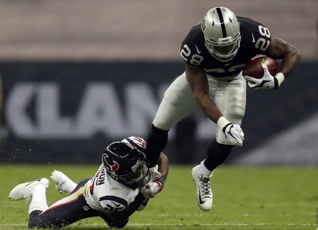 MEXICO CITY, MEXICO - NOVEMBER 21: Latavius Murray #28 of the Oakland Raiders is tackled by Kareem Jackson #25 of the Houston Texans in their game at Estadio Azteca on November 21, 2016 in Mexico City, Mexico. (Photo by Buda Mendes/Getty Images)