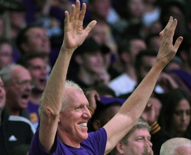 Former NBA player Bill Walton celebrates as he watches his son Luke coach his first regular NBA game with the Lakers during the second half of an NBA basketball game between the Lakers and the Houston Rockets, Wednesday, Oct. 26, 2016, in Los Angeles. The Lakers 120-114. (AP Photo/Mark J. Terrill)