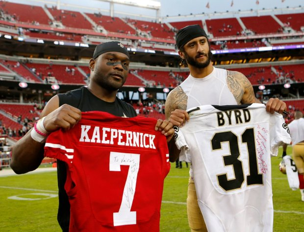 New Orleans Saints' Jairus Byrd (31) poses for photograph with San Francisco 49ers quarterback Colin Kaepernick (7) after exchanging team jersey after their NFL game at Levi's Stadium in Santa Clara, Calif., on Sunday, Nov. 6, 2016. (Josie Lepe/Bay Area News Group)