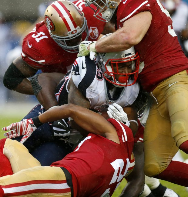 New England Patriots' Dion Lewis (33) is tackled San Francisco 49ers' Gerald Hodges (51), 49ers' Nick Bellore (50) and 49ers' Keith Reaser (27) in the third quarter of their NFL game at Levi's Stadium in Santa Clara, Calif., on Sunday, Nov. 20, 2016. (Nhat V. Meyer/Bay Area News Group)