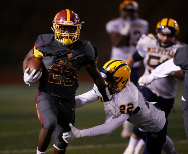 Menlo-Atherton's Jordan Mims breaks a tackle by Milpitas' Tai Nguyen on his way to a touchdown in the fourth quarter during the Central Coast Section Open Division I championship game at Independence High School Friday, Nov. 25, 2016, in San Jose, Calif. (Jim Gensheimer/Bay Area News Group)
