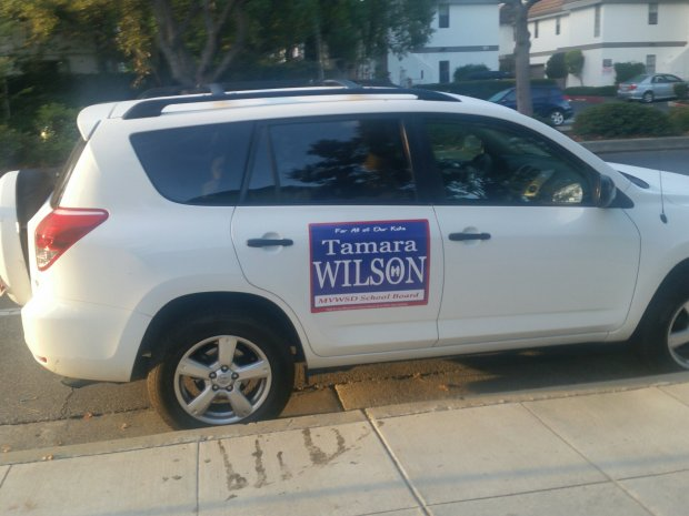 Tamara Wilson, who finished at the top of a field of four vying for three seats on the Mountain View Whisman School Board, campaigned vigorously, including outfitting her car with her campaign signs. (Photo courtesy Tamara Wilson)