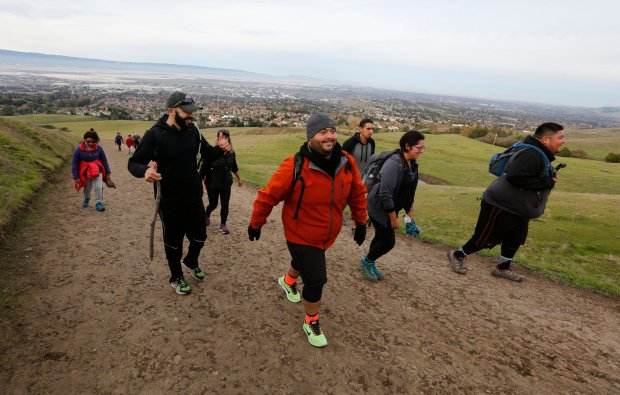 Eder Castro from San Bruno, right, joins Ana Espinola from South San Francisco, Josue Lemus from Burlingame, Mikey Quintero from South San Francisco and others on a hike up to Mission Peak in Fremont, Calif., on Friday, Nov. 25, 2016. Castro hosted the hike as part of the @52HikeChallenge in partnership with REI , encouraging people to spend the day outside as an alternative to the Black Friday shopping chaos. (Laura A. Oda/Bay Area News Group)