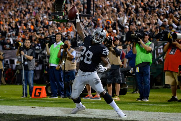 Oakland Raiders' Latavius Murray (28) spikes the ball after catching a 1-yard touchdown pass against the Denver Broncos in the second quarter of their NFL game at the Coliseum in Oakland, Calif., on Sunday, Nov. 6, 2016. The touchdown would be nullified after a penalty on the Raiders. (Jose Carlos Fajardo/Bay Area News Group)