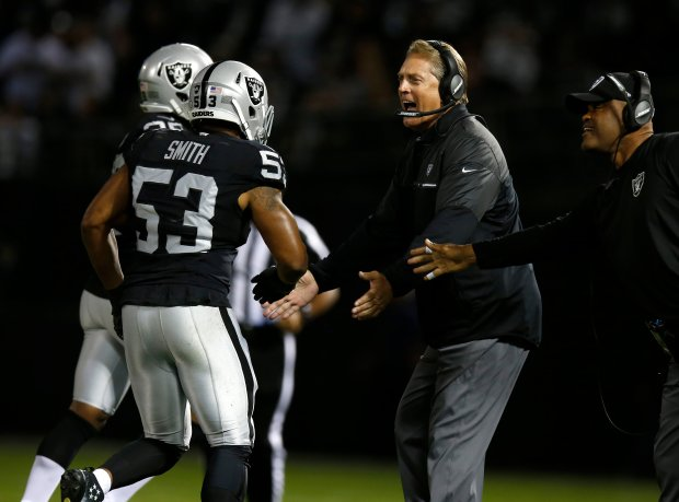 Oakland Raiders head coach Jack Del Rio cheers after the Raiders defense made a stop against the Denver Broncos in the first quarter of their NFL game at the Coliseum in Oakland, Calif., on Sunday, Nov. 6, 2016. (Nhat V. Meyer/Bay Area News Group)