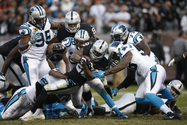 Oakland Raiders' Latavius Murray (28) rushes against the Carolina Panthers during the Raiders' final scoring drive in an NFL game at the Coliseum in Oakland, Calif., on Sunday, Nov. 27, 2016. (Karl Mondon/Bay Area News Group)