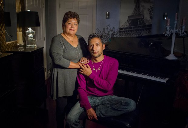 From right, Trump supporter Juan Hernandez, 38, and his mother Josie Hernandez, 65, a Clinton supporter, pose for a portrait at Juan's home in Santa Clara, Calif., on Wednesday, Nov. 9, 2016. (LiPo Ching/Bay Area News Group)