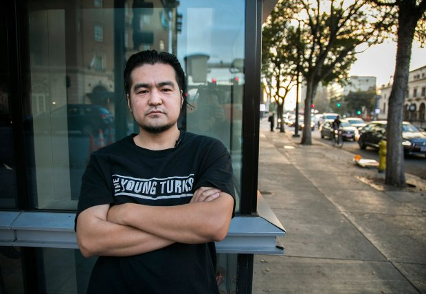 Trump protester Phuc Le, 36, of San Jose, poses for a portrait on the street where Trump supporters and protestors clashed after a Trump rally on June 2, 1016, in downtown San Jose, Calif., on Thursday, Nov. 10, 2016. (LiPo Ching/Bay Area News Group)
