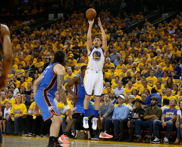 Golden State Warriors' Klay Thompson (11) takes a three-point shot (that he missed) against the Oklahoma City Thunder in the second quarter of Game 2 of the NBA Western Conference finals at Oracle Arena in Oakland, Calif., on Wednesday, May 18, 2016. (Nhat V. Meyer/Bay Area News Group)