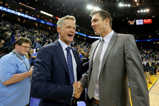 Golden State Warriors head coach Steve Kerr, left, shake hands with his former assistant and now Los Angeles Lakers head coach Luke Walton after the Warriors 149-106 win at Oracle Arena in Oakland, Calif., on Wednesday, Nov. 23, 2016. (Ray Chavez/Bay Area News Group)