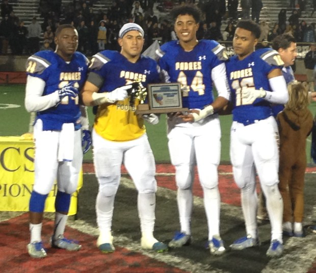 The Serra football captains accept the CCS Open Division II championship trophy after a 37-24 victory over Mitty on Friday at Westmont High in Campbell. (Vytas Mazeika / Daily News)