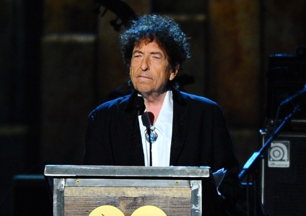 FILE - In this Feb. 6, 2015 file photo, Bob Dylan accepts the 2015 MusiCares Person of the Year award at the 2015 MusiCares Person of the Year show in Los Angeles. The Swedish Academy says Dylan is not coming to Stockholm to pick up his 2016 Nobel Prize for literature at the Dec. 10, 2016 prize ceremony. (Photo by Vince Bucci/Invision/AP, File)