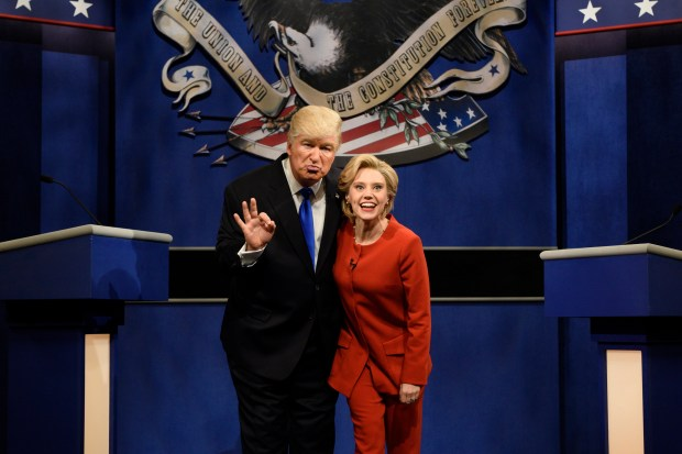 "FILE - In a Saturday, Oct. 1, 2016 file photo provided by NBC, Alec Baldwin, left, as Republican presidential candidate, Donald Trump, and Kate McKinnon, as Democratic presidential candidate, Hillary Clinton, perform on the 42nd season of ""Saturday Night Live,"" in New York. Republican presidential candidate Donald Trump tweeted early Sunday morning, Oct. 16, 2016, that the show's skit depicting him this week was a ""hit job."" Trump went on to write that it's ""time to retire"" the show, calling it ""boring and unfunny"" and adding that Alec Baldwin's portrayal of him ""stinks."" (Will Heath/NBC via AP, File)"