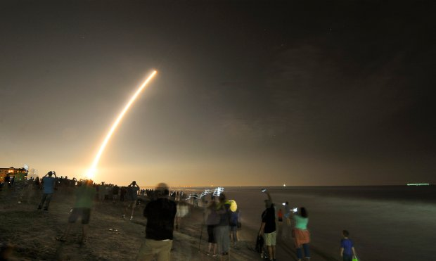 Cell phones light up the beaches of Cape Canaveral and Cocoa Beach, Fla., north of the Cocoa Beach Pier as spectators watch the launch of the NOAA GOES-R weather satellite, Saturday, Nov. 19, 2016. It was launched from Launch Complex 41 at Cape Canaveral Air Force Station on a ULA Atlas V rocket. (Malcolm Denemark/Florida Today via AP)