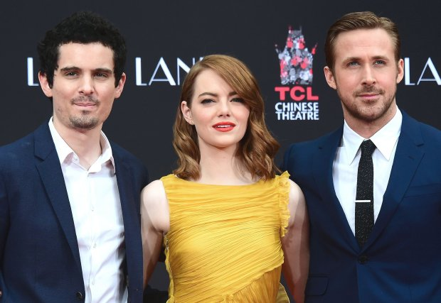 """La La Land"" writer-director Damien Chazelle with stars Emma Stone and RyanGosling in Los Angeles Dec. 7. (Frederic J. Brown/AFP/Getty Images)"