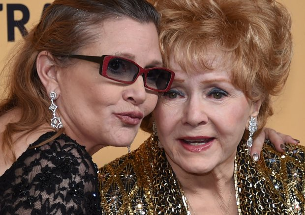 FILE - DECMEBER 28: According to reports December 28, 2016 Debbie Reynolds was rushed to a Los Angeles area hospital with a possible stroke. Reynolds is the mother of Carrie Fisher who died December 27 after suffering a heart attack days earlier. LOS ANGELES, CA - JANUARY 25: Actresses Debbie Reynolds (R), recipient of the Screen Actors Guild Life Achievement Award, and her daughter Carrie Fisher pose in the press room during the 21st Annual Screen Actors Guild Awards at The Shrine Auditorium on January 25, 2015 in Los Angeles, California. (Photo by Ethan Miller/Getty Images)