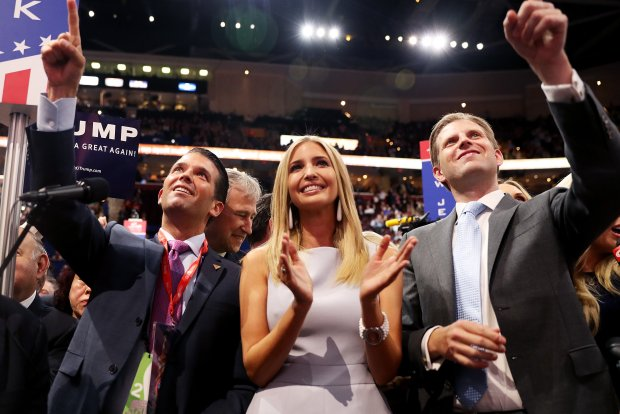 YEAR IN FOCUS - NEWS (1 of a set of 85) CLEVELAND, OH - JULY 19: Donald Trump Jr. (L), along with Ivanka Trump (C) and Eric Trump (R), take part in the roll call in support of Republican presidential candidate Donald Trump on the second day of the Republican National Convention on July 19, 2016 at the Quicken Loans Arena in Cleveland, Ohio. An estimated 50,000 people are expected in Cleveland, including hundreds of protesters and members of the media. The four-day Republican National Convention kicked off on July 18. (Photo by Joe Raedle/Getty Images)