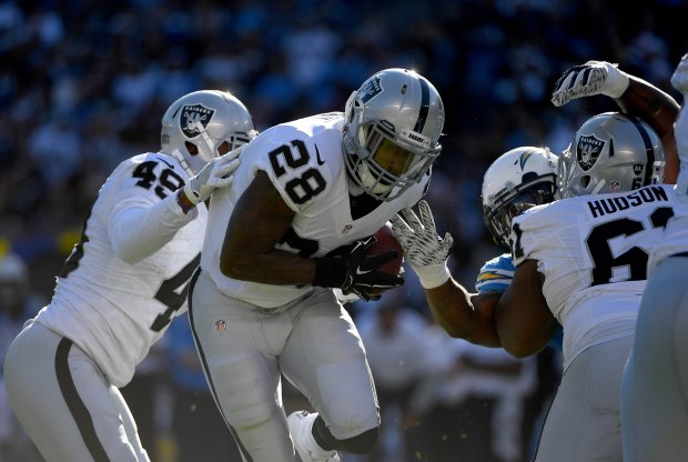 Runningback Latavius Murray #28 of the Oakland Raiders runs for a gain during his team's game against the San Diego Chargers at Qualcomm Stadium on December 18, 2016 in San Diego, California. (Photo by Donald Miralle/Getty Images)